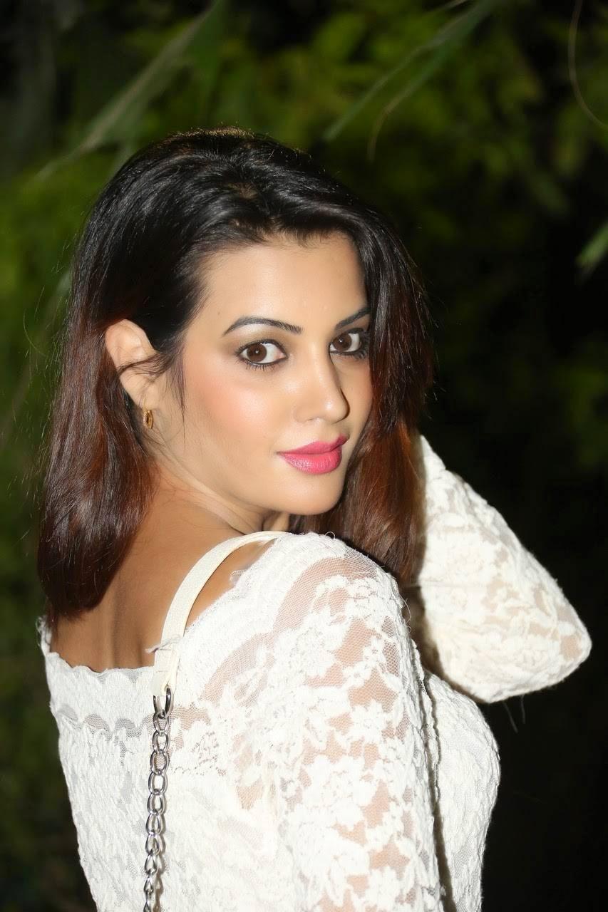 Actress Diksha Panth images, Actress Diksha Panth Crossleg Sitting Pics in White Dress from Event