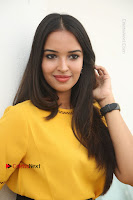 Actress Poojitha Stills in Yellow Short Dress at Darshakudu Movie Teaser Launch .COM 0176.JPG