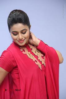 Actress Poorna Latest Stills in Red Dress at Rakshasi First Look Launch  0159.JPG
