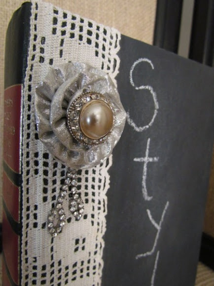 chalkboard book embellished with vintage jewels and lace