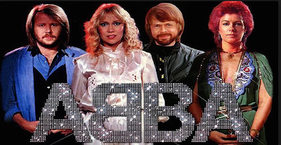 Pic of the four band members from ABBA in seventies glitter clothing