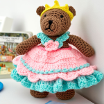 http://www.redheart.com/free-patterns/princess-bear-play-set