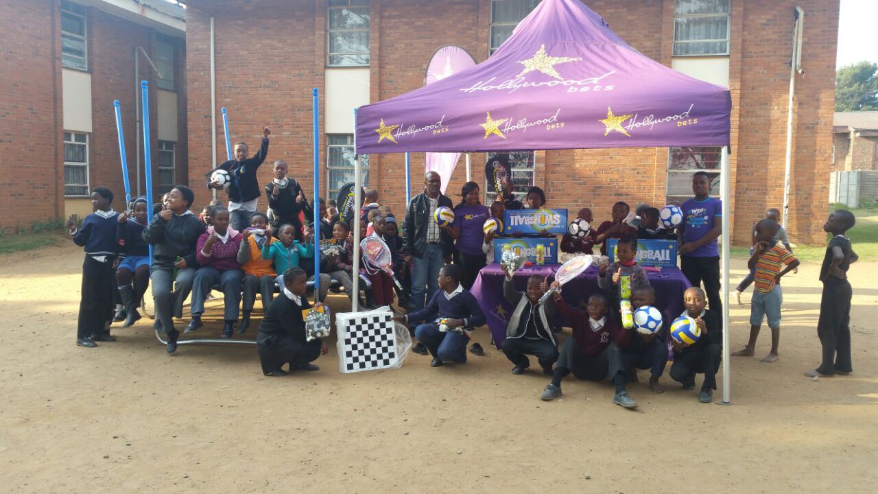 Happy faces at Children of the Dawn Ermelo as they receive a donation of sporting equipment and games from Hollywoodbets Secunda
