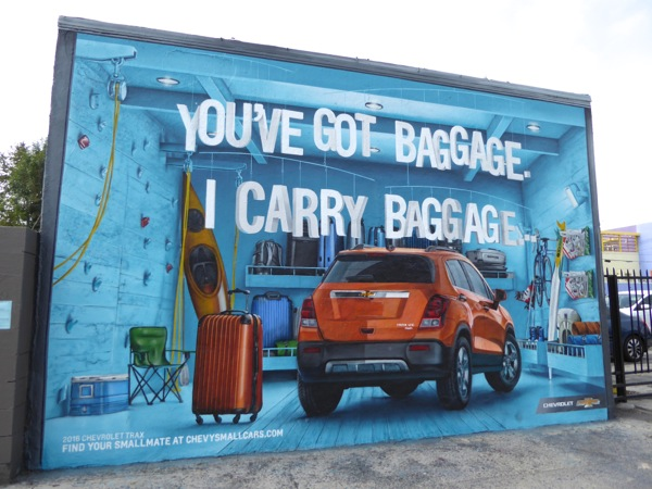 Youve got baggage Chevy small cars wall mural ad