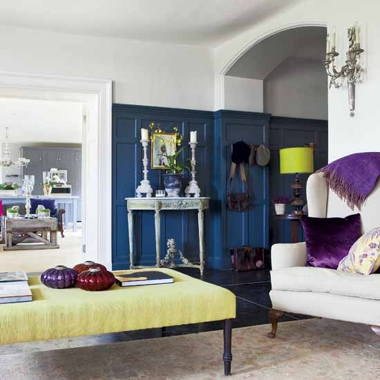 Colourful Grand Living Room. This Seating Area, Lifted With Jewel Toned  Accents Against Dramatic Deep Blue Panelling, Flows Into The Kitchen Beyond  Via A ...