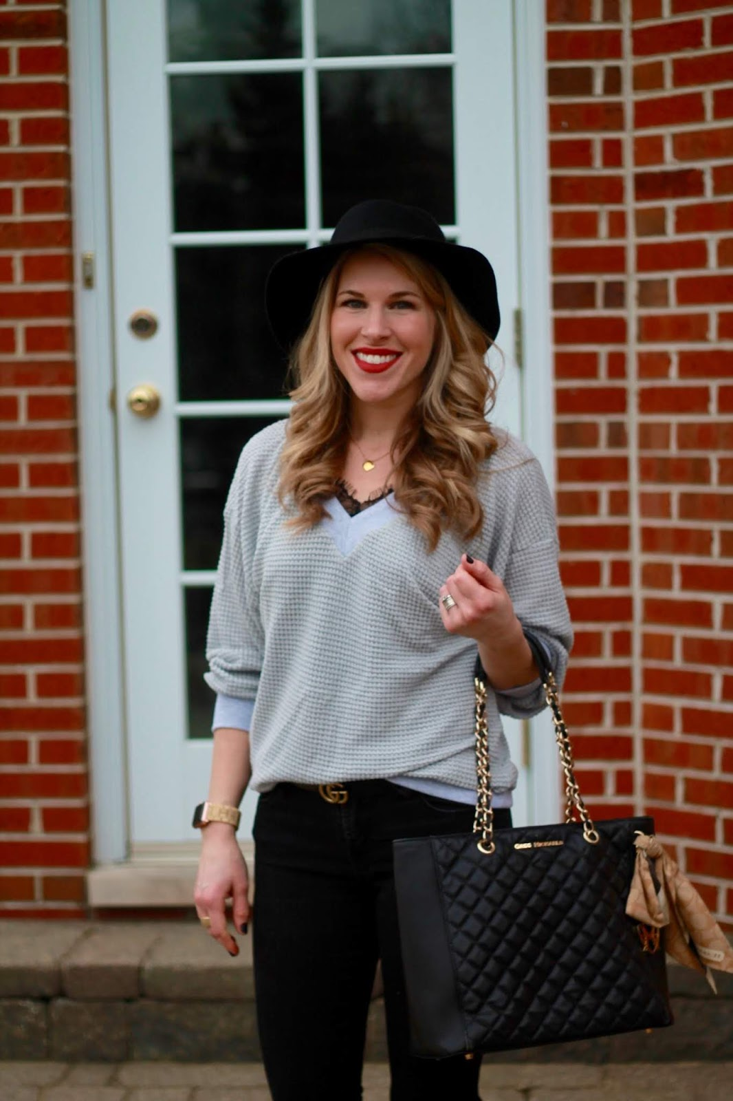 grey waffle knit sweater, black lace cami, black distressed jeans, black quilted tote, black fedora, leopard booties