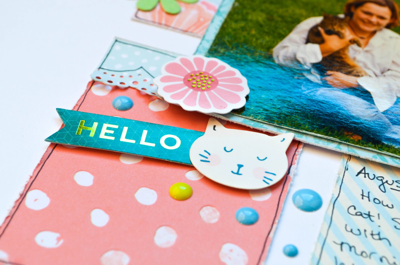 Pastel cat scrapbook page layout in pinks, blues, and greens. with thickers, rainbow, sequins, die cuts