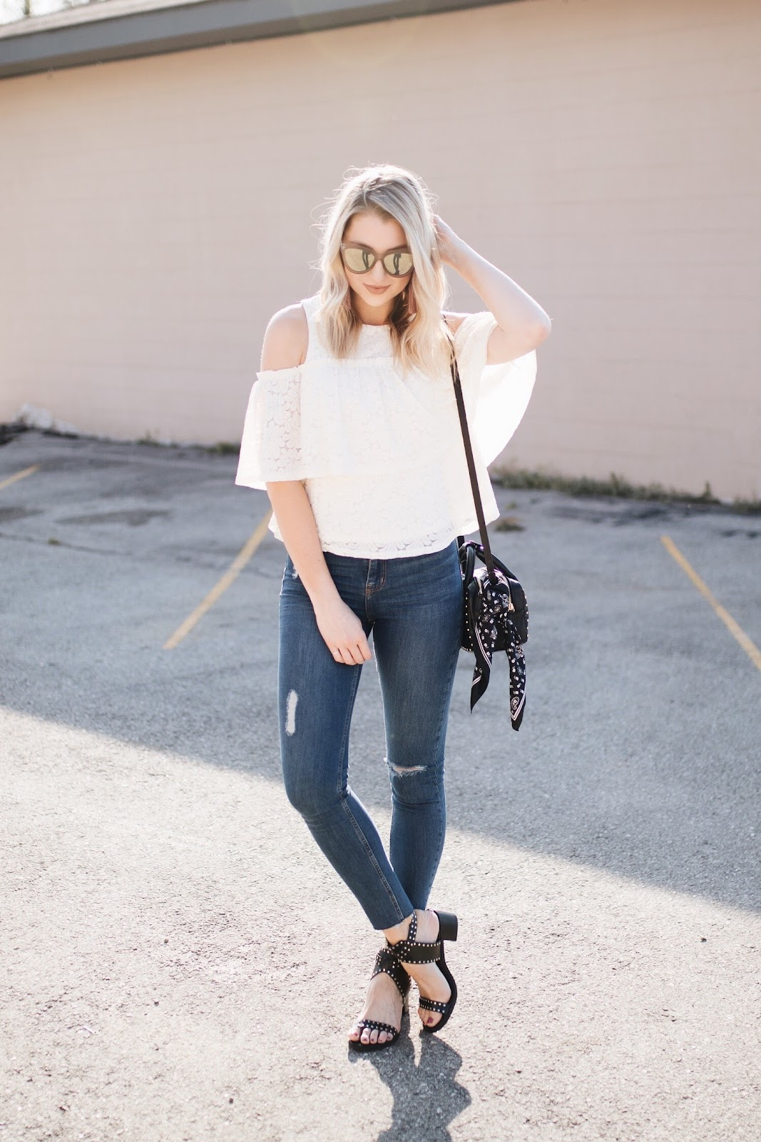 spring outfit idea: cold shoulder top, skinny jeans, studded sandals