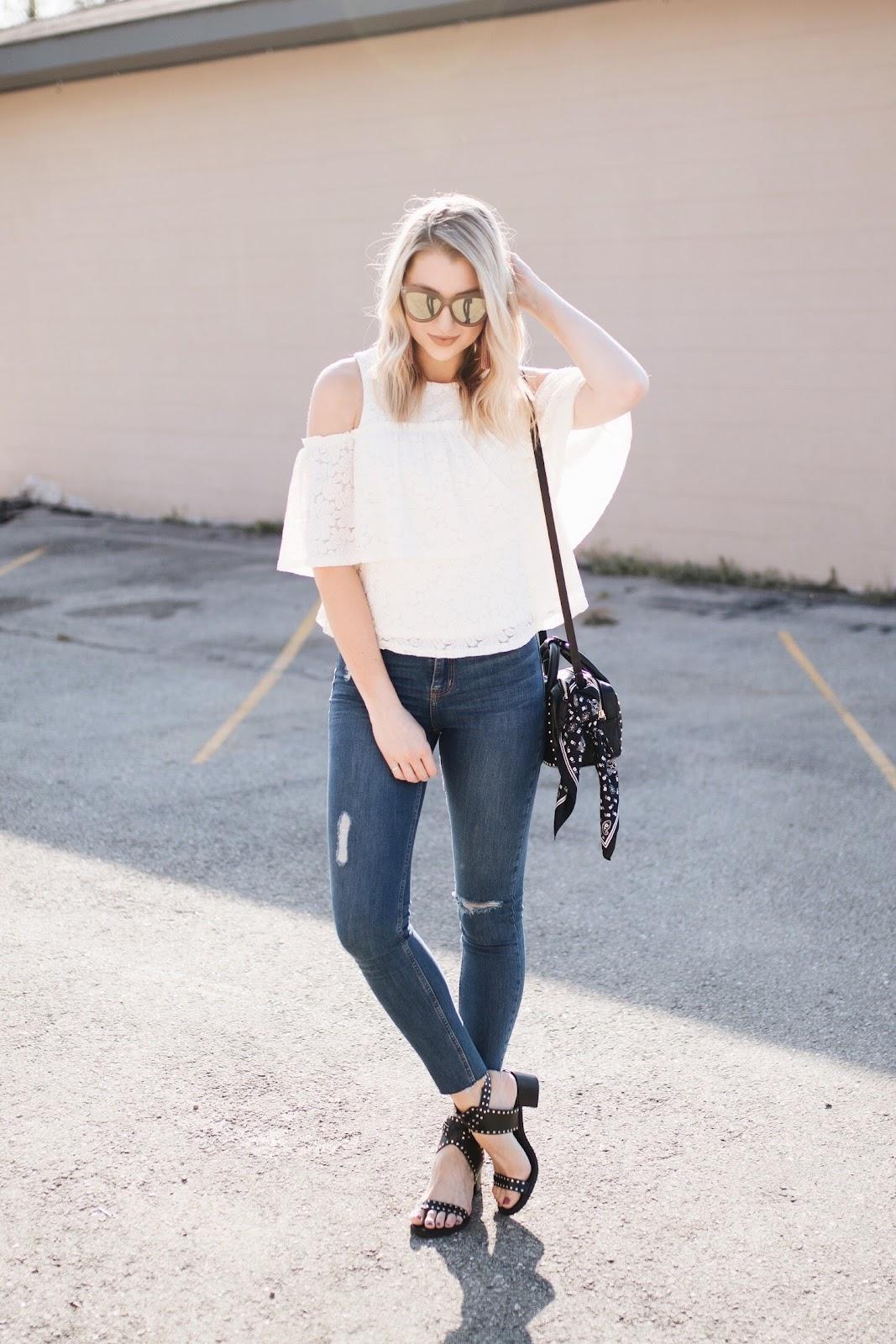 spring outfit idea: cold shoulder top, skinny jeans, studded sandals