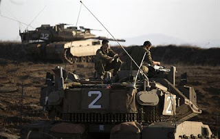 Israeli_Tank_in_the_Golan_Heights_region