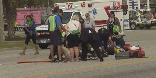 Twelve injured after car ploughs into high school marching band at Alabama Mardi Gras parade