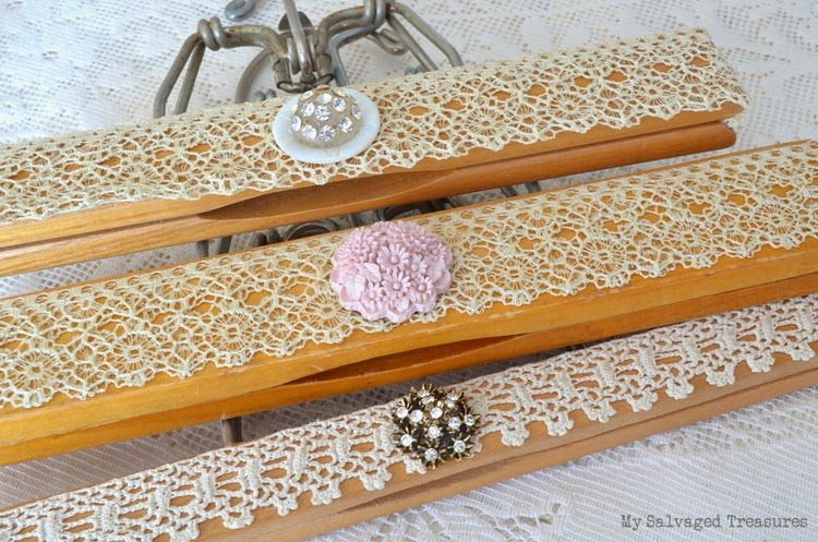 decorated hangers with lace and buttons