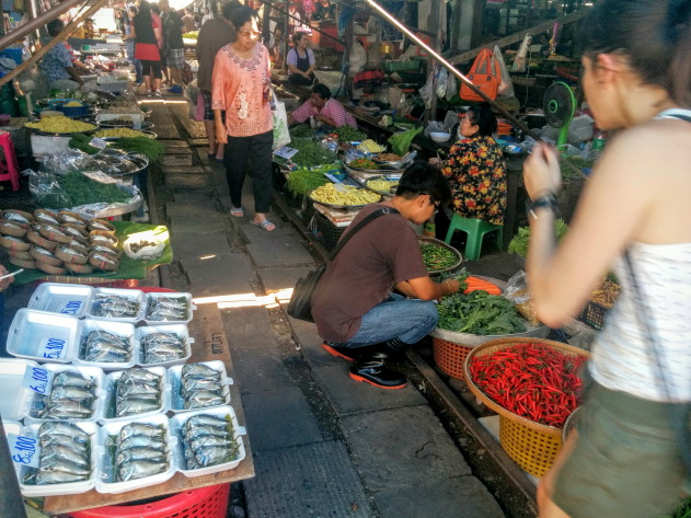Step into the risky market at Mae Klong, Thailand