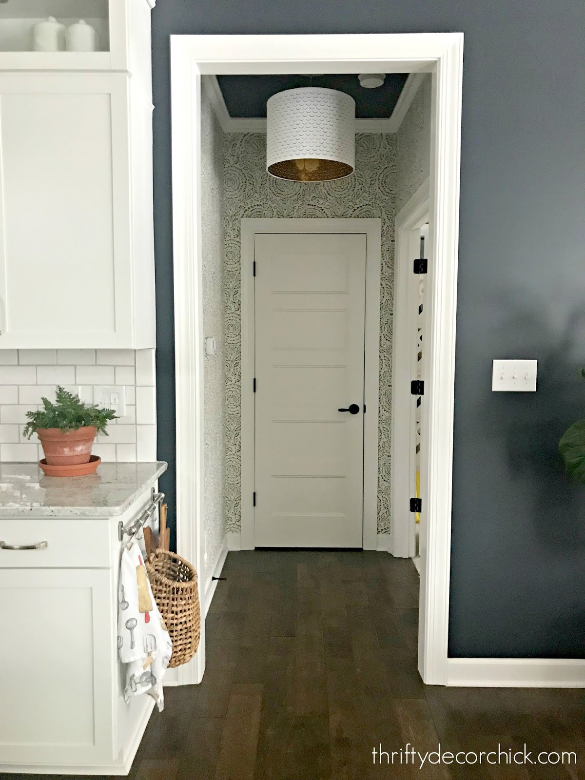 Decorating a small hallway with wallpaper and paint