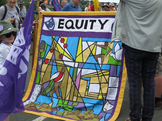 Brightly coloured, stained-glass style banner from the Union Equity.