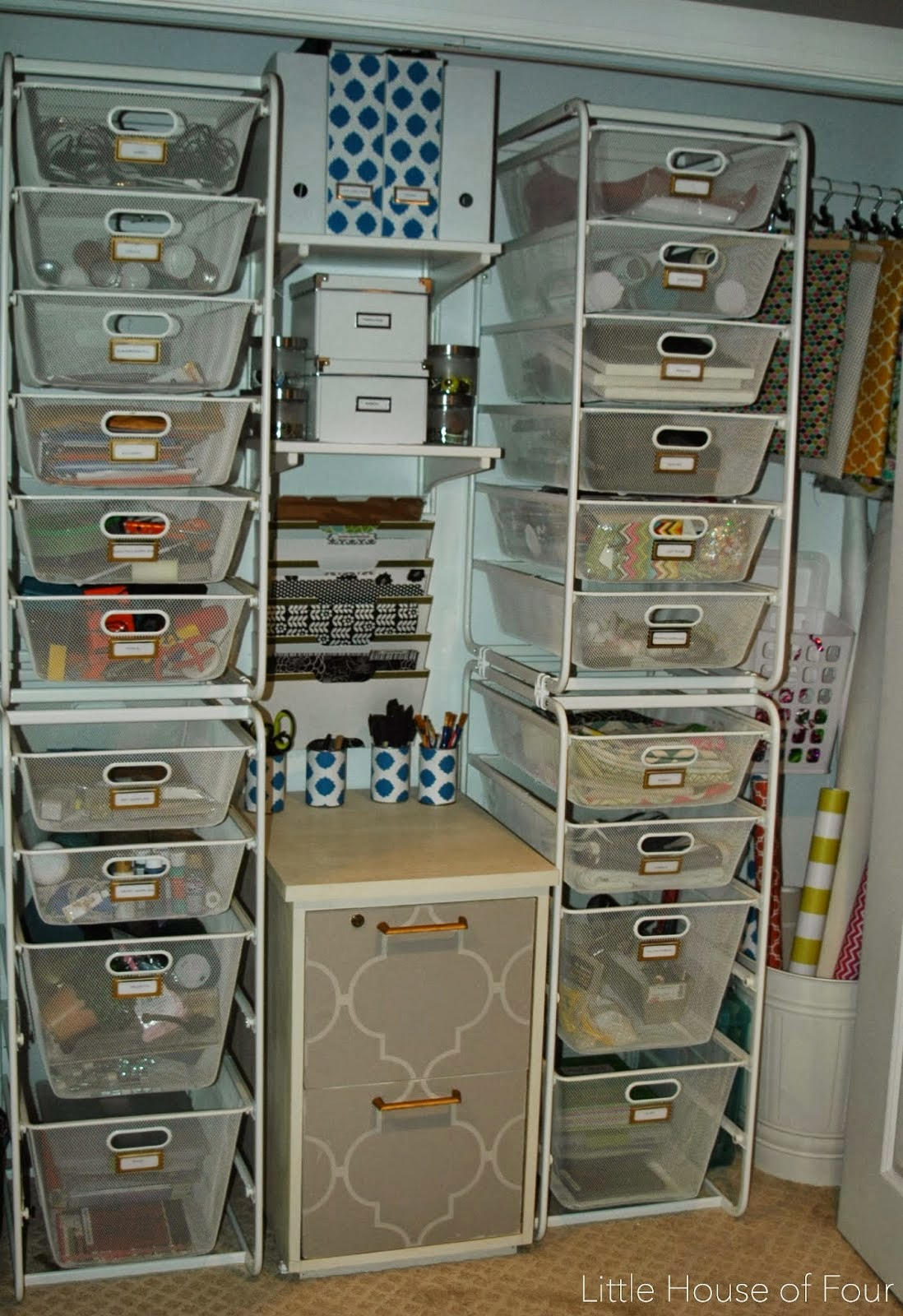 Two shelfves with bines and drawers full of supplies.
