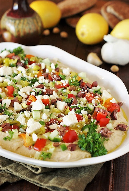 Loaded Hummus Dip Image. Entertain with ease with a platter of Loaded Hummus Dip ~ easy, stress-free, and always a hit!