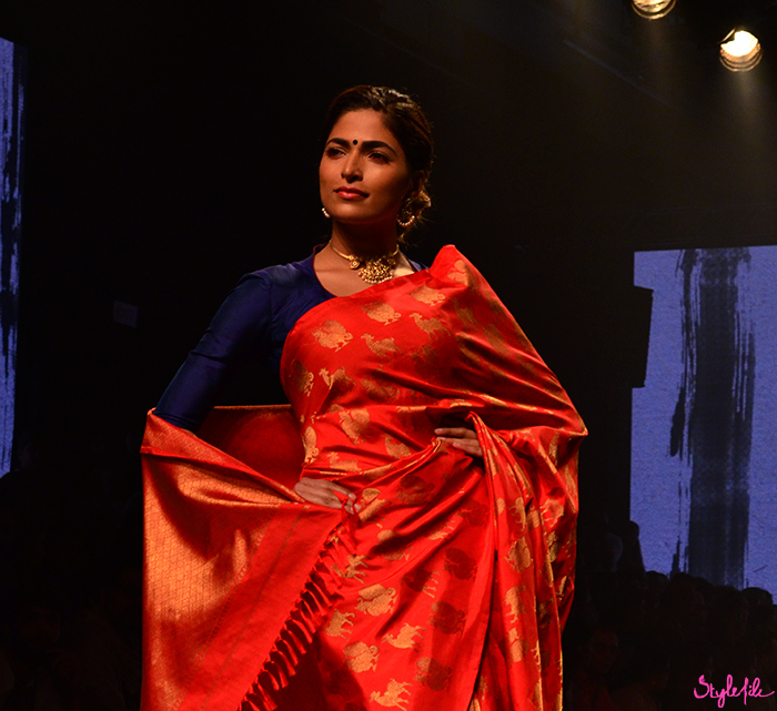 Image of female model wearing full filled in eye brows as a beauty trend for Tulsi Silks on the runway at Lakme Fashion Week Winter Festive 2016