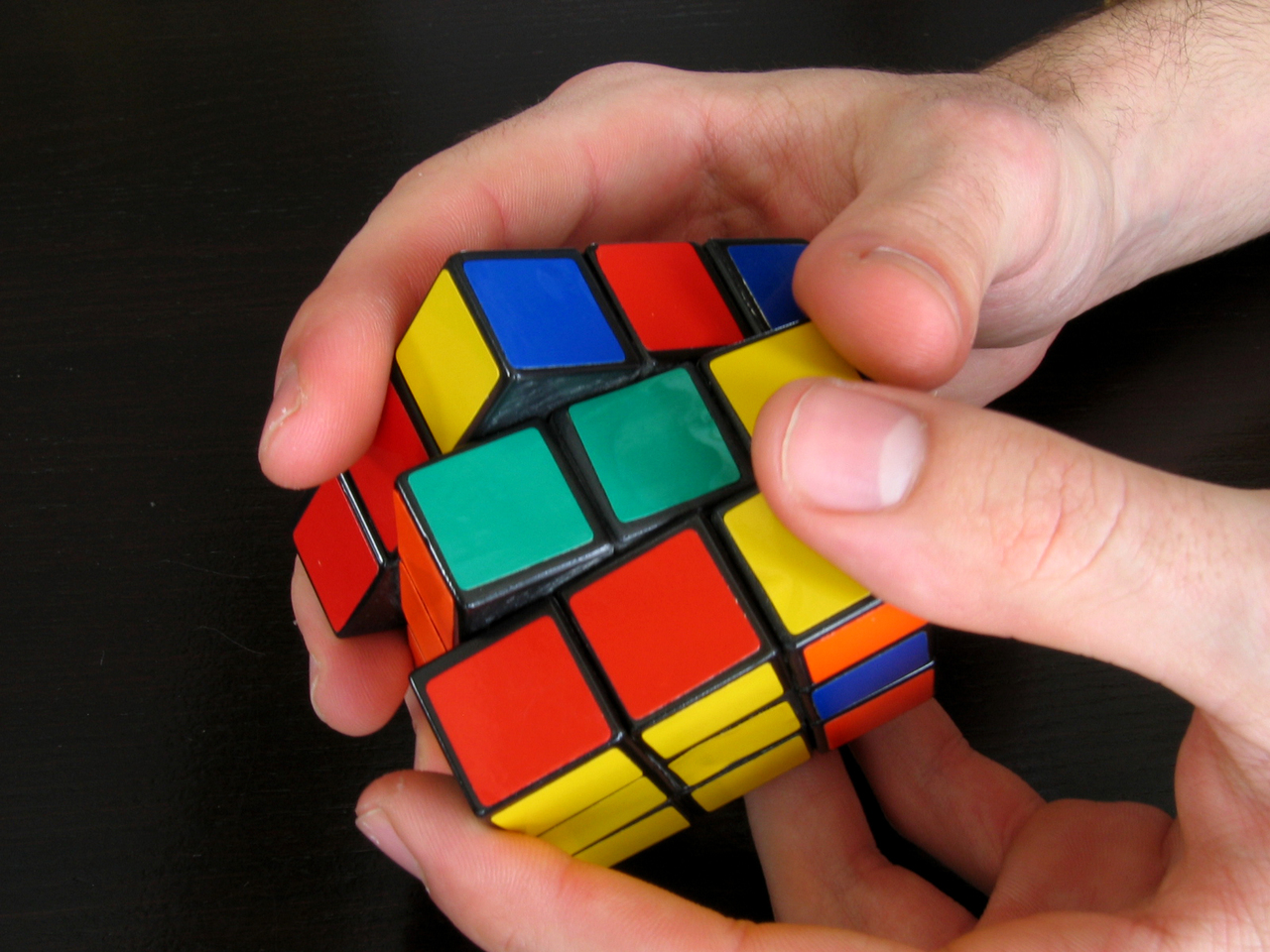 Teenage Boy From China Solver Three Rubik's Cube with hands and feet at the same time, makes record