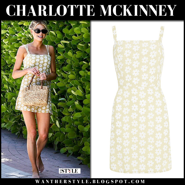 Charlotte McKinney in yellow floral print mini dress faithfull the brand summer style july 16