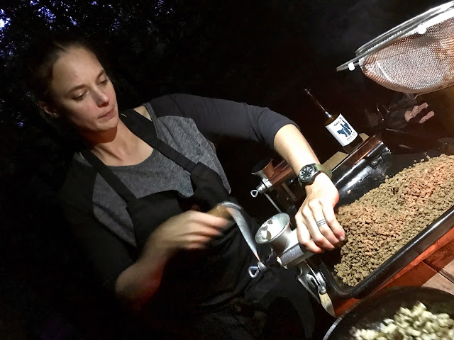 chef Titti Qvarnstrom, grinding acorns for burgers,  pure food camp, Skane, Sweden