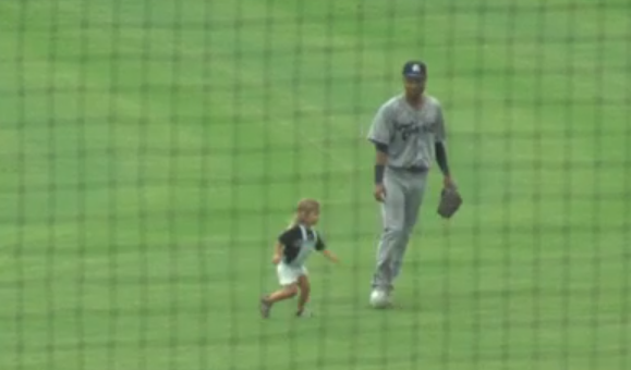 Little girl runs onto field during Asheville-Charleston minor league baseball game