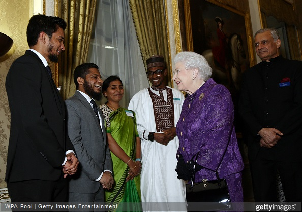 Elizabeth II speaks with guests during a reception to mark Commonwealth Day at Marlborough House