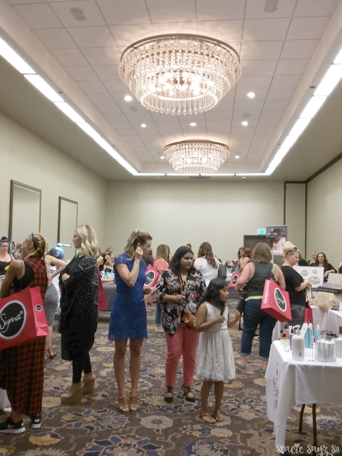 women shopping at a makeup show