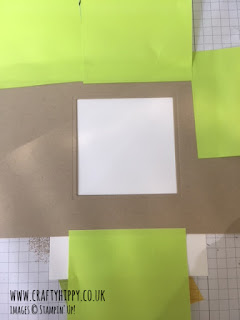 This image shows you how to mask off an area for sponging on colour in cardmaking and scrapbooking.