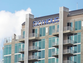 SkyHouse roof-level signage on high-rise apartment tower