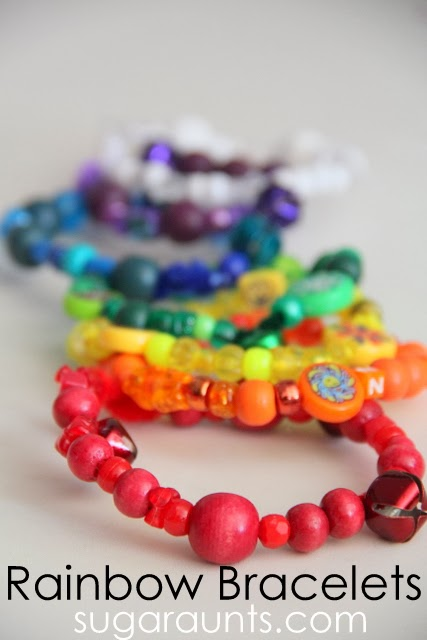 Fine motor craft with beads and pipe cleaners to make these rainbow bracelets.