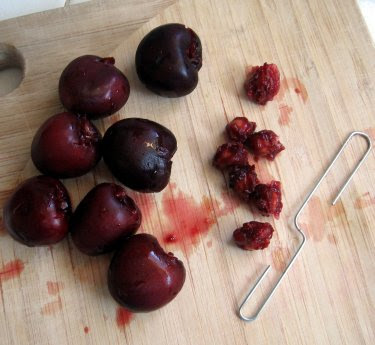 cherries pitted with a paperclip