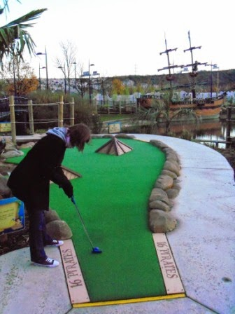 Emily Gottfried playing at Bluewater's Pirate Cove Adventure Golf in December 2011