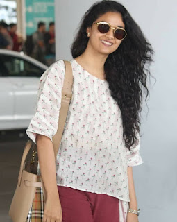 Mana Keerthy Suresh: Keerthy Suresh in White and Maroon Dress with Cute Smile Captured at Hyderabad Airport