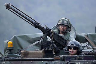 North Korea Says U.S. Forced It to Build Strongest Nuke to power U.S. soldiers on M113 armored vehicles take part during the Warrior Strike VIII exercise at the Rodriguez Range on