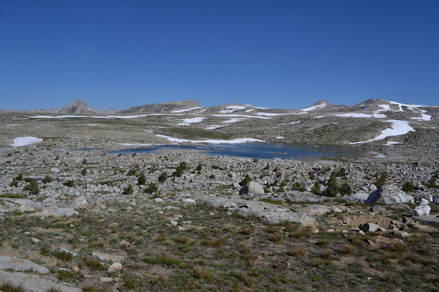 sprawl of a lake on a sprawl of granite