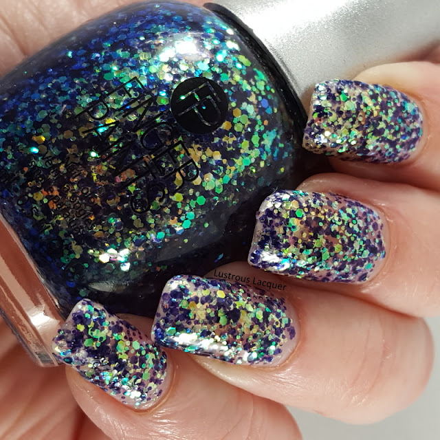 Multi-sized-duochrome-glitter-in-a-clear-base-nail-polish
