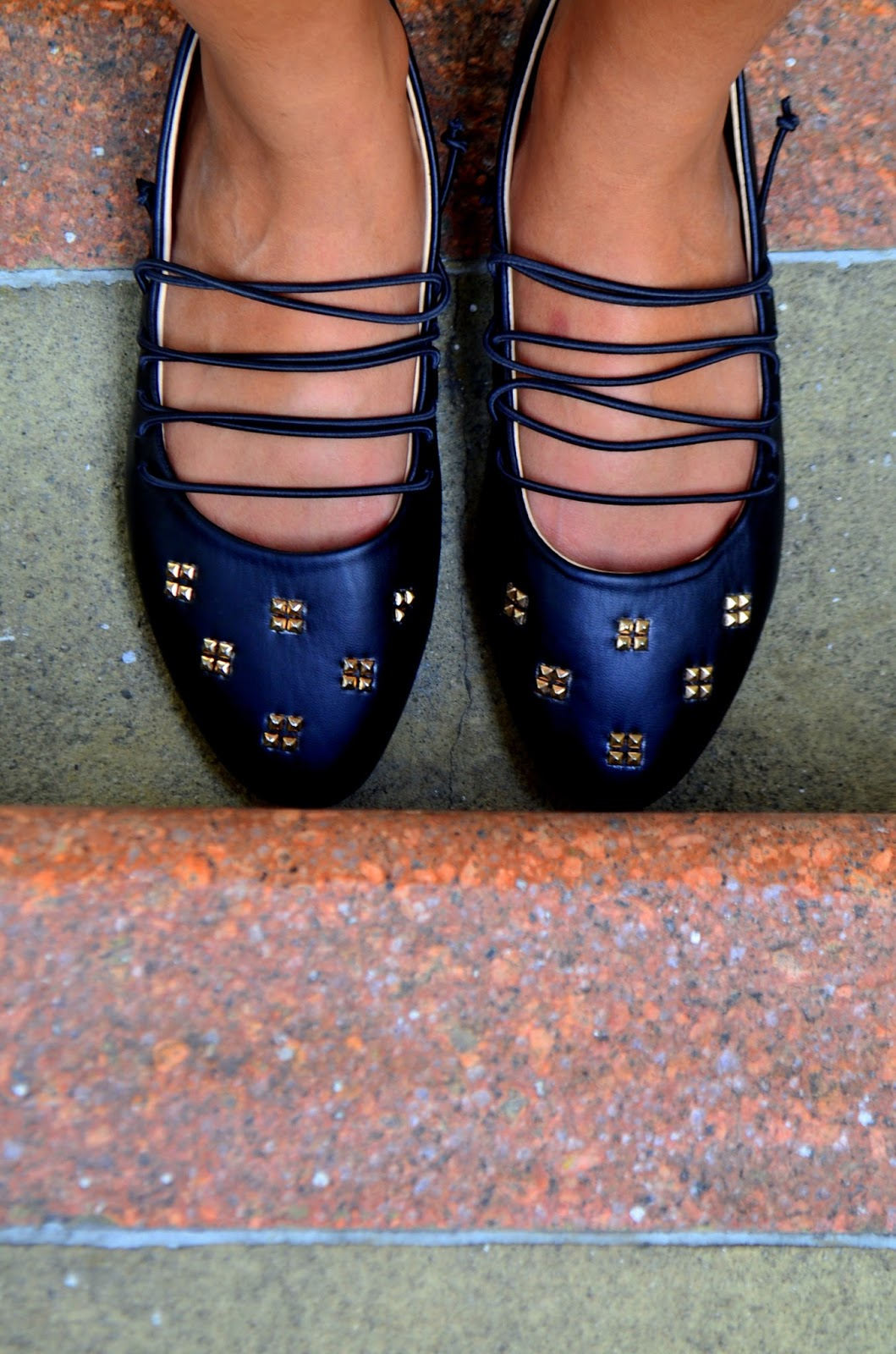 black laced up flats