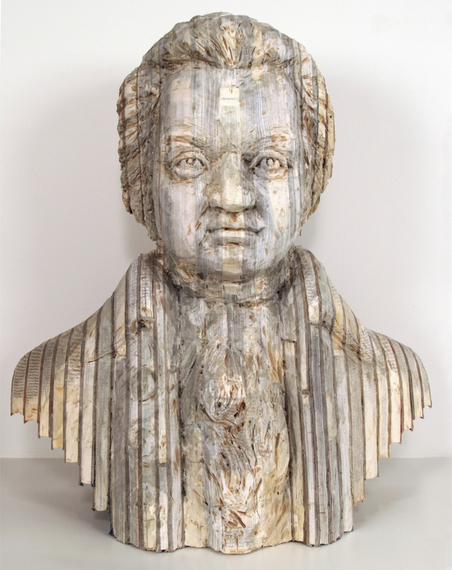 07-Mozart-Long-Bin-Chen-A-Second-Life-for-Recycled-Book-Sculpting-www-designstack-co