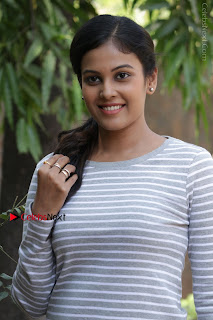 Tamil Actress Chandini Tamilarasan Latest Pos in Ripped Jeansat Ennodu Vilayadu Press Meet  0006.jpg