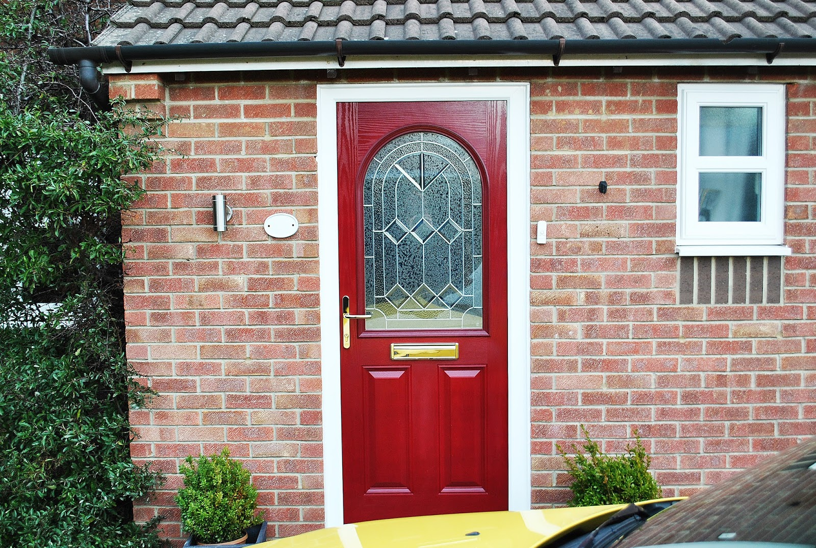 A Bold Statement - Red Composite front Door, With Arched Glass Panel ...