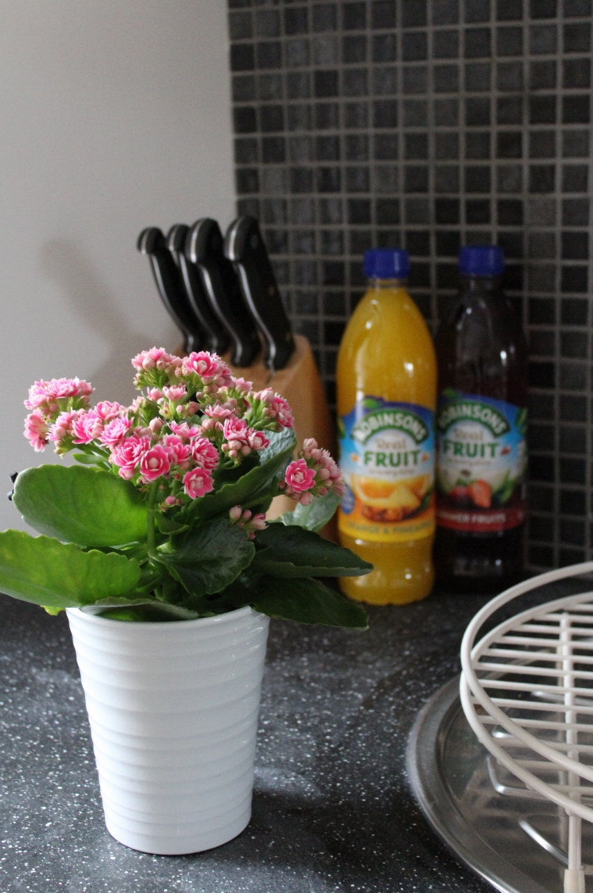 Pink flowers in kitchen