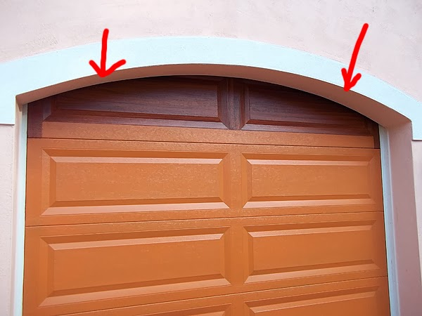 paint top panel of garage door to look like wood.