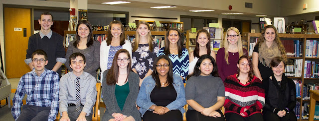 The newest members of the Peter Rickard Chapter of the National Honor Society pose for a photo inside Tri-County's library ahead of an induction ceremony on Tuesday, November 15