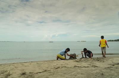 youth Making Sandcastles Puro Pinget Island Magsingal Ilocos Sur Philippines