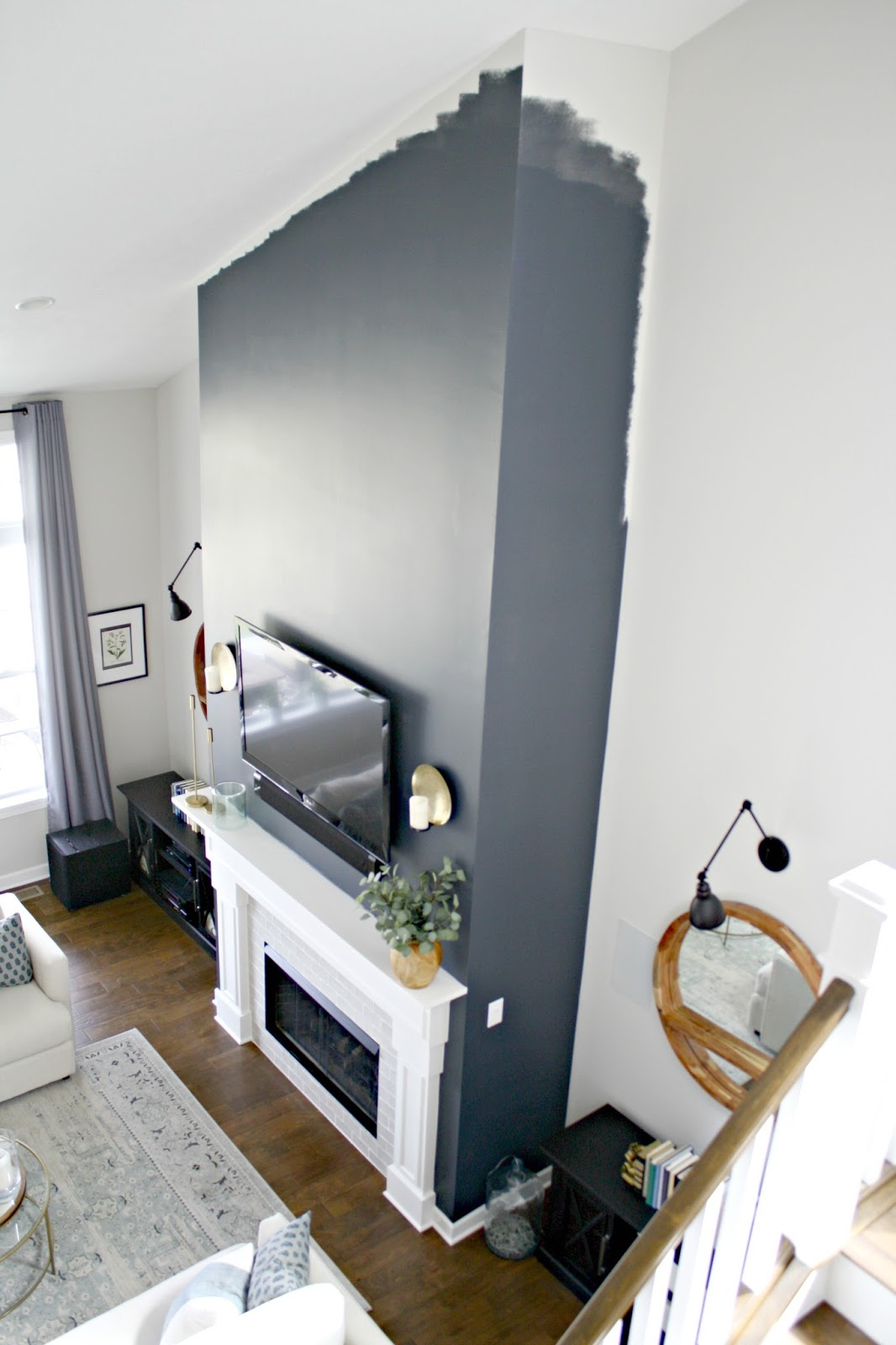 Two story fireplace wall in dark blue/gray