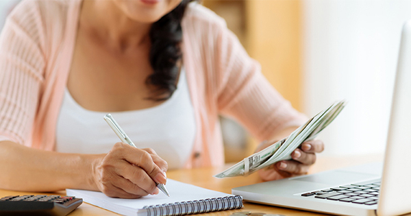 Woman creating budget