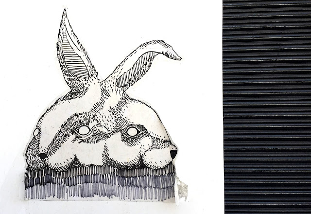 Dual white rabbits wall art