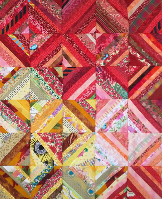 Quilt blocks composed of strips of red fabric or yellow fabric.
