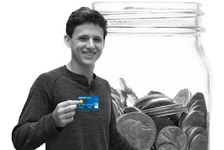 Teen holding secured credit card.
